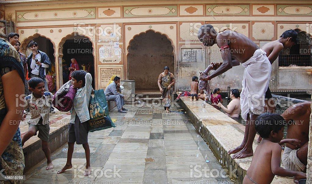 Indian pilgrims bathing in sacred water of Galtaji. royalty-free stock photo