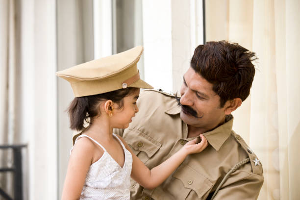 Indian Police Man With Daughter Stock Photo
