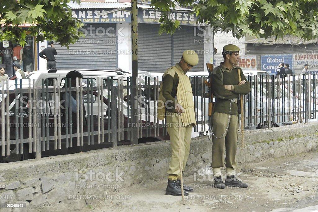 Indian policemen on a street of Srinagar, Kashmir, India stock photo