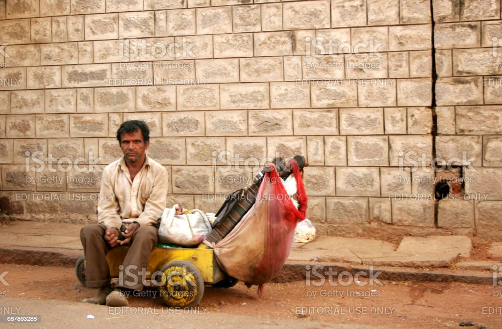 Indian poor and sick man with leprosy beg or seek help on road stock photo