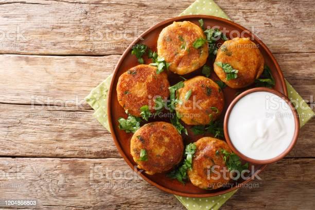 Indian Potato Patties Aloo Tikki Served With Yogurt Close Up In A Dish Horizontal Top View Stock Photo - Download Image Now