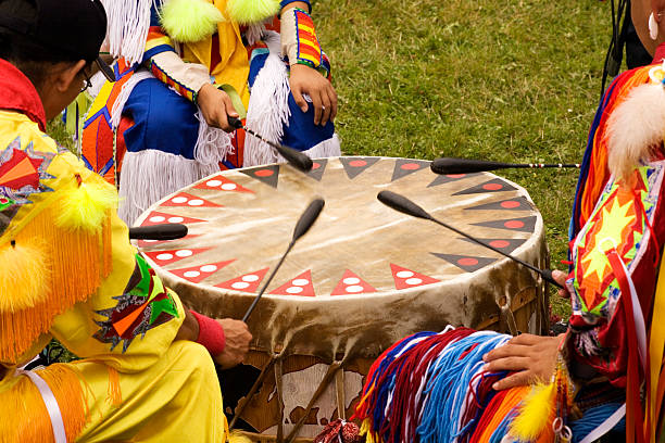 Indian Pow Wow Beating Drum at Indian Pow Wow  Teamwork Colorful regalia indigenous peoples of the americas stock pictures, royalty-free photos & images