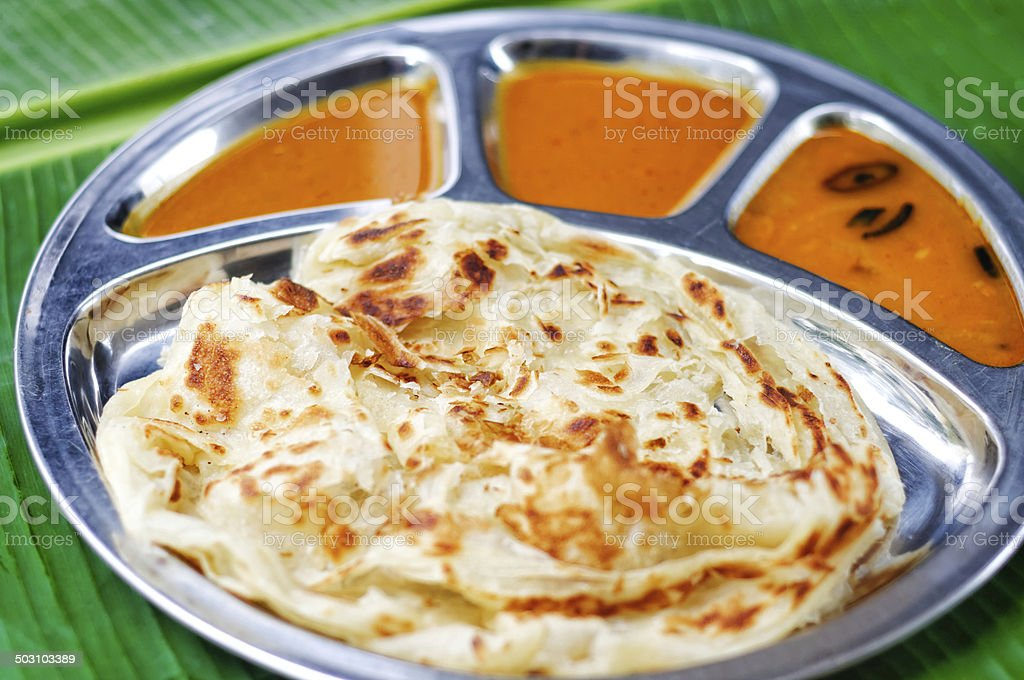 Indian prata bread served with curry stock photo