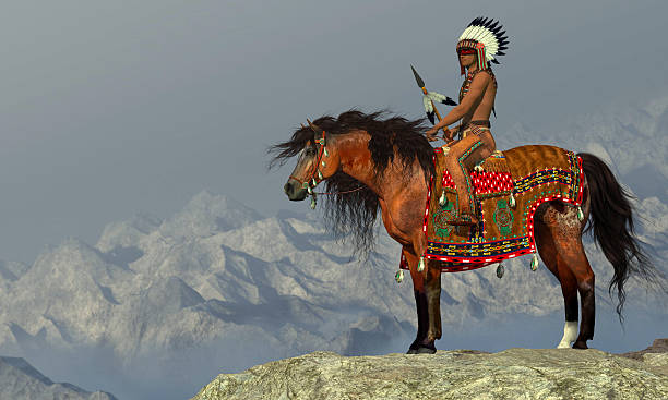 Indian Proud Eagle An American Indian sits on his Appaloosa horse on a high cliff in a desert area. indigenous peoples of the americas stock pictures, royalty-free photos & images