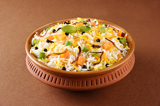 indian pulav, vegetable rice, veg biryani, basmati rice The Indian Pulav vegetables and The rice is browned in oil and then mixed with vegetables nuts, fruits etc. Basmati Rice,Vegetable Rice dal makhani stock pictures, royalty-free photos & images