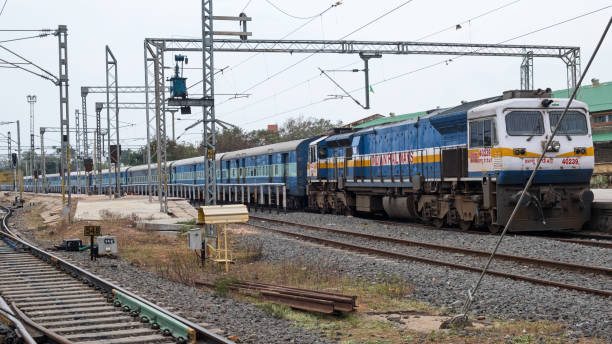 Indian Railways passenger train about to depart Pondicherry in Tamil Nadu Pondicherry, India - March 17, 2018: Indian Railways passenger train about to leave the main station at Pondicherry in Tamil Nadu. The Indian rail network covers 75,000 miles and carries an estimated 23 million passengers each day depart stock pictures, royalty-free photos & images