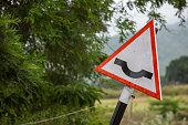 Road sign along the Tamil Nadu - Karnataka border, Talamalai Reserve Forest