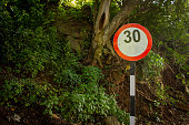 Indian road sign indicating speed limit in the ghat road of Yercaud, Salem, Tamil Nadu, India