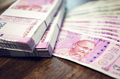 istock Indian Rupee money stacks and banknotes on the table 999754108
