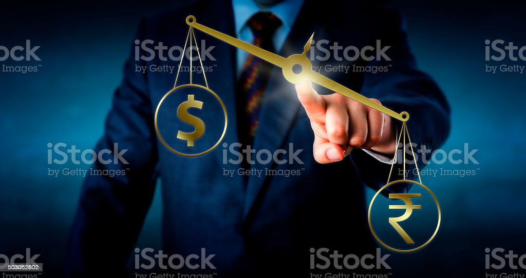 Indian Rupee Outbalancing The US Dollar stock photo
