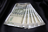 istock Indian Rupees - 500 Rs notes on black background 1219691466