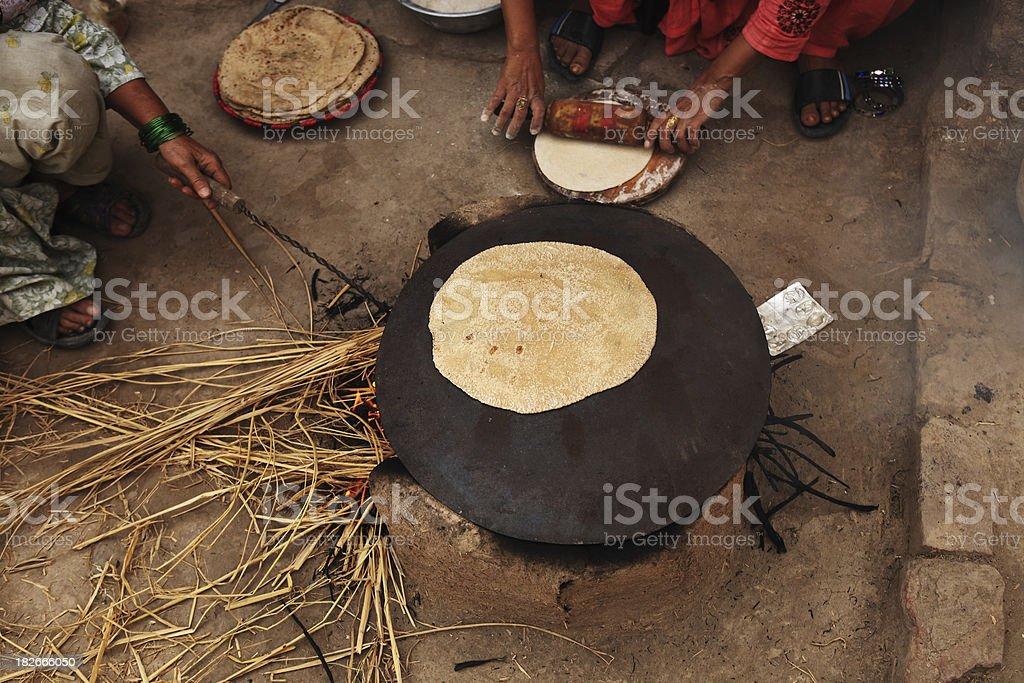 Indian Rural Lifestyle Making Chapati Mud Stove stock photo