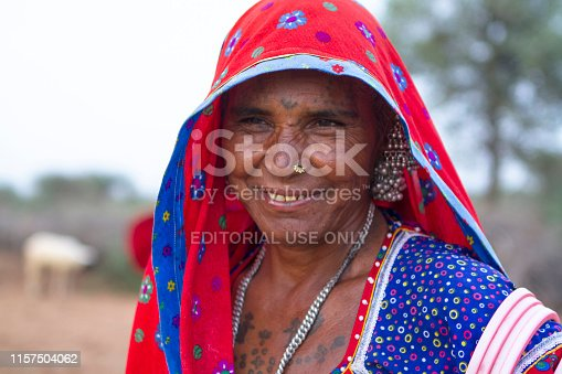 Jodhpur, India - July 14, 2013: Rural woman in traditional casual From jodhpur, Standing in her farm house for look after for there animal