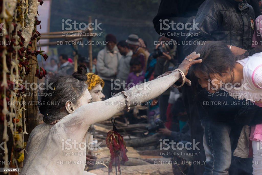 Indian sadhu blessing woman stock photo