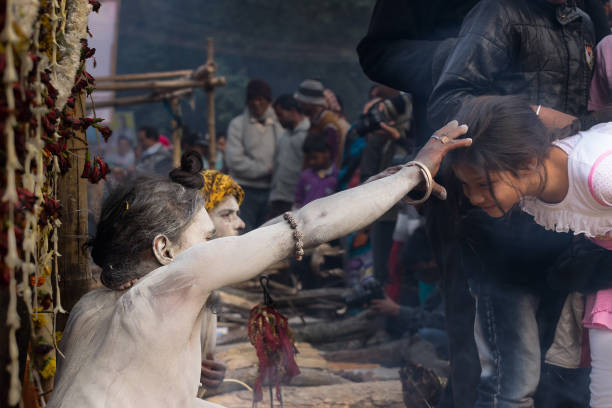 indian sadhu blessing woman - religious celebration stock photos and pictures
