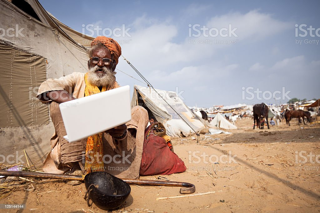 indian sadhu surfing the internet stock photo