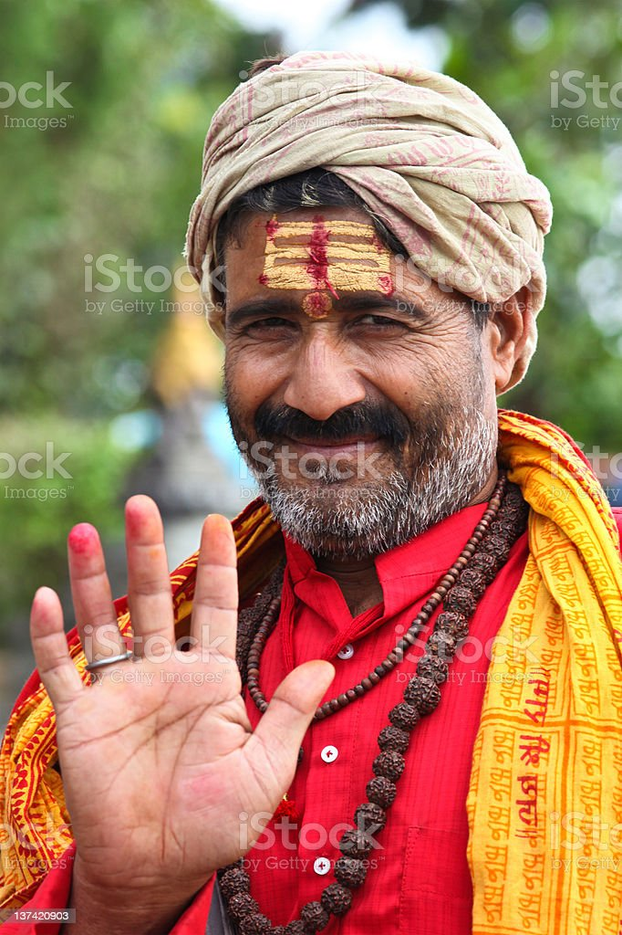 Indian sadhu welcomes royalty-free stock photo