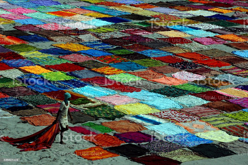 Indian saris drying along the river bank in Agra. stock photo