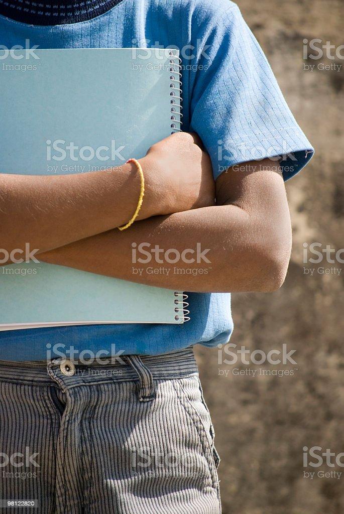 Indian school boy con portatile foto stock royalty-free