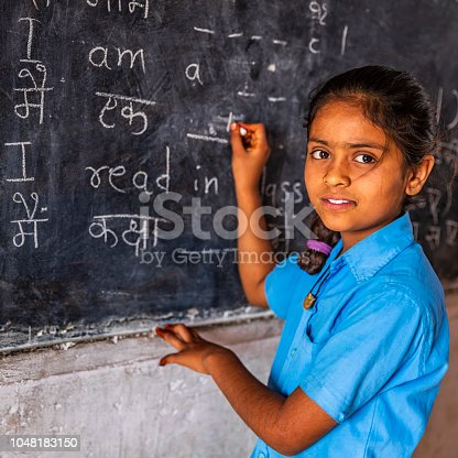 Indian schoolgirl in classroom, English language class, Rajasthan, India