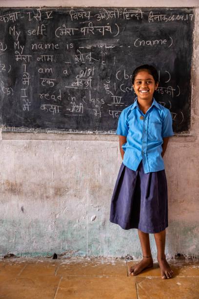 Indian schoolgirl in classroom stock photo