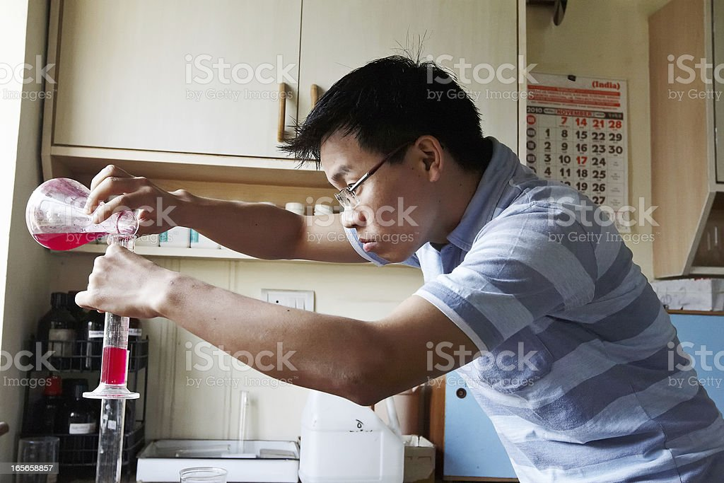 Indian science student working in University laboratory royalty-free stock photo