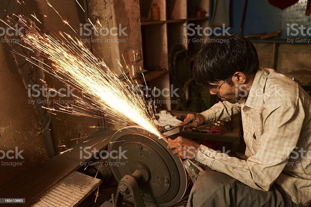 Indian scissors sharpener stock photo