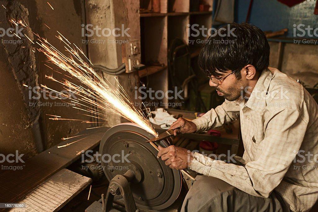 Indian scissors sharpener royalty-free stock photo