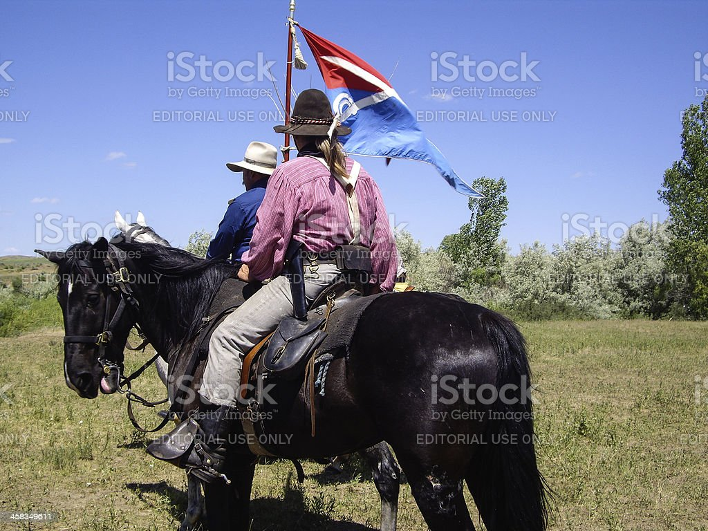 Indian Scout and US Cavalryman on horseback royalty-free stock photo