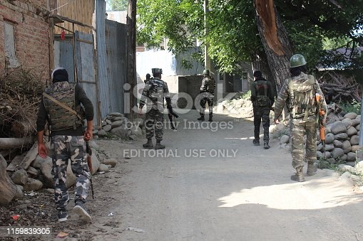 Security personnel patrolling During Corden-and-search operation (CASO) at Ougmuna Village of Kunzer in north of Kashmir on Wednesday 03, July, 2019.