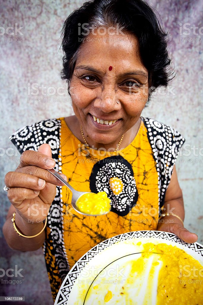 Indian Senior Offering a bite royalty-free stock photo
