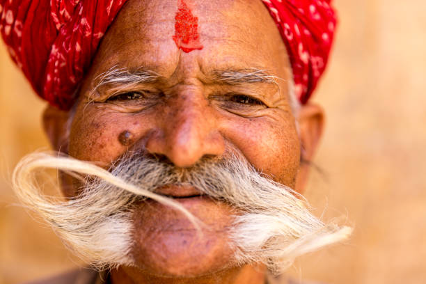 Indian senior with a huge mustache in Jaisalmer Fort, Rajasthan, India The best of Rajasthan in India udaipur stock pictures, royalty-free photos & images