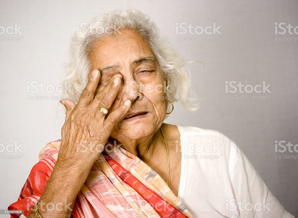 Indian Senior woman in Pain Health Problems royalty-free stock photo