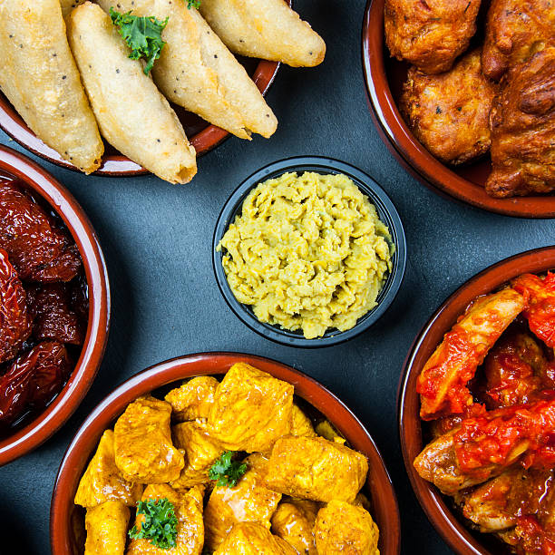 Indian snacks in bowls stock photo