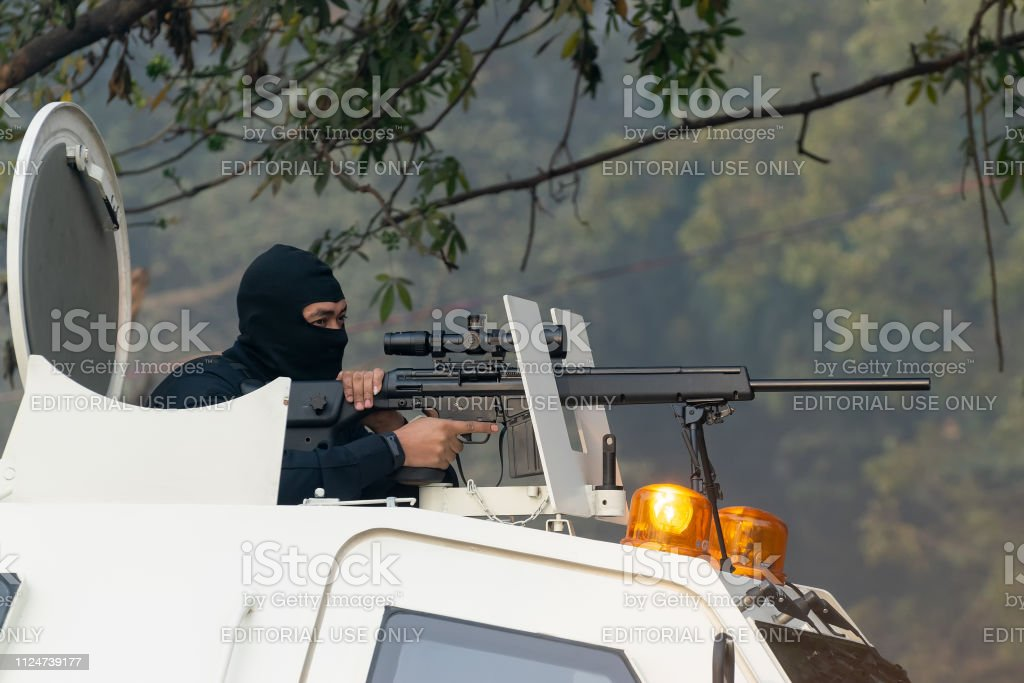 India\'s National Cadet Corps\'s masked sharp shooter cadet with a...