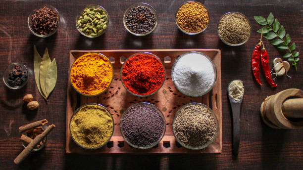 indian spices and essential kitchen ingredients - indian food stock pictures, royalty-free photos & images