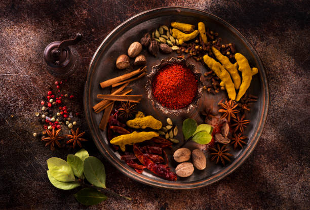 Indian spices and herbs on a dark concrete background Indian spices and herbs on a dark concrete background garam masala stock pictures, royalty-free photos & images