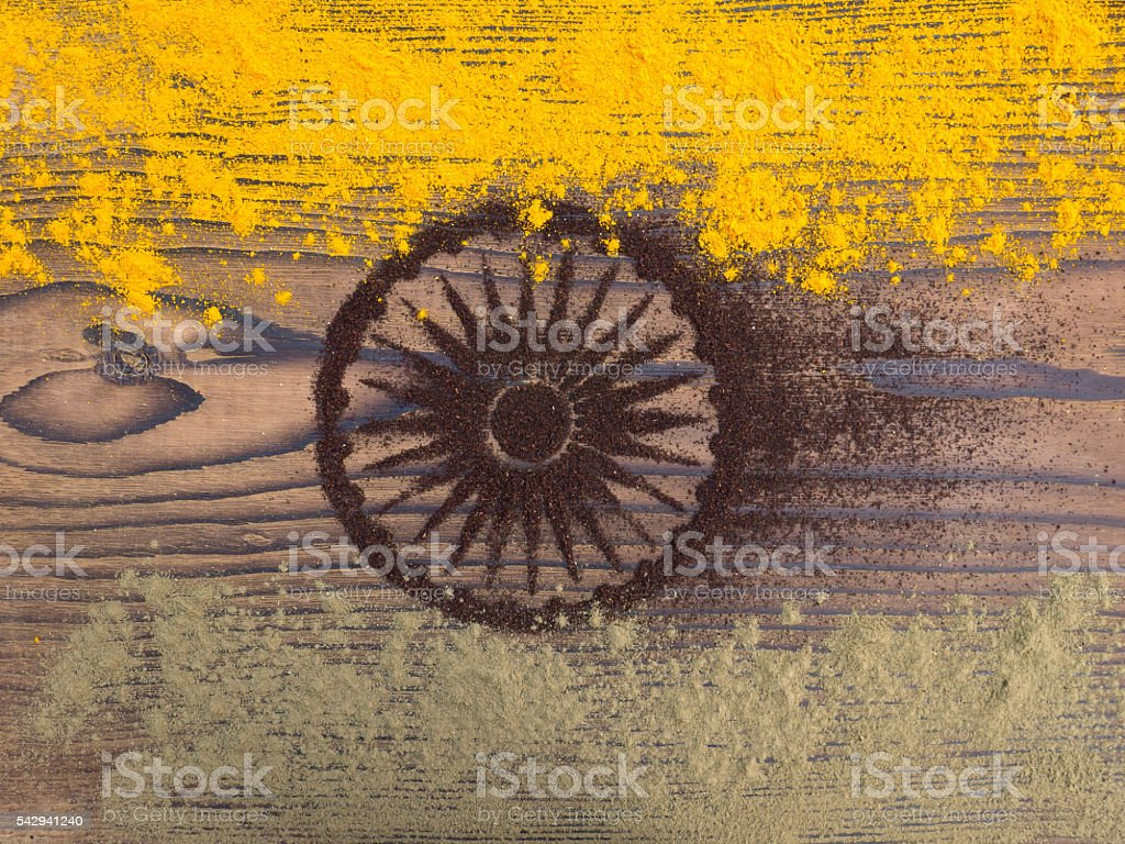 Indian spices and tea powder forming India flag stock photo