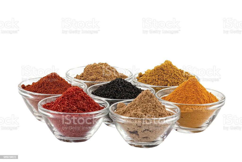 indian spices in glass bowls stock photo