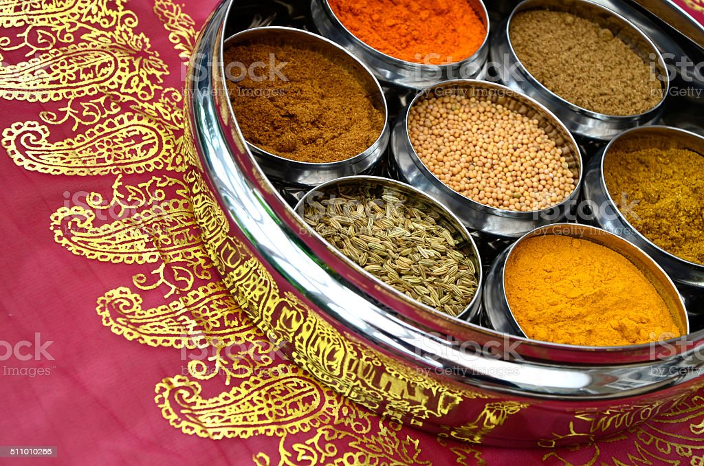 Indian Spices in Silver Pots on Pink and Gold Sari stock photo