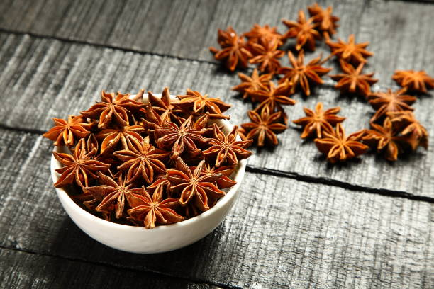Indian spices- organic star anise Background of Indian exotic spice- star anise star anise stock pictures, royalty-free photos & images