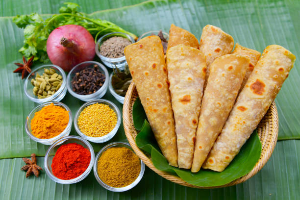 Indian spicy potato curry or aloo masala served with roti or chapati stock photo