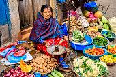 Indian vegetable seller on the streets of Kathmandu, Nepal.