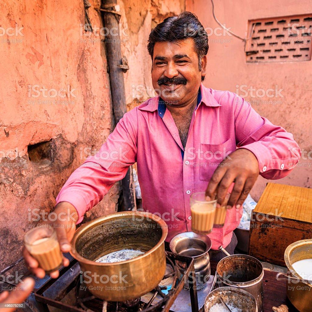 Indian street seller selling tea - masala chai in Jaipur stock photo