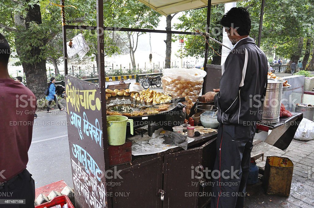 Indian street vendor selling chaat at street stock photo