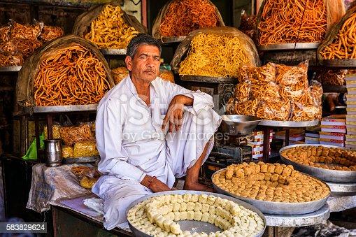 istock Indian street vendor selling sweets near Jaipur, India 583829624