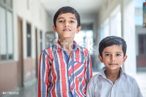 941782244 istock photo Indian Students in school uniform 941782310