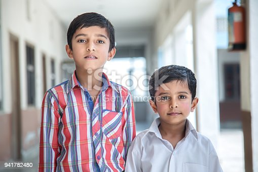 941782244 istock photo Indian Students in school uniform 941782480