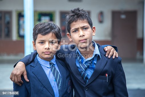 941782244 istock photo Indian Students in school uniform 941784636