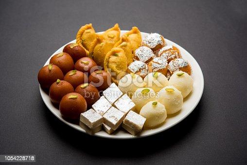 istock Indian sweets in a plate includes Gulab Jamun, Rasgulla, kaju katli, morichoor / Bundi Laddu, Gujiya or Karanji for diwali celebration 1054228718